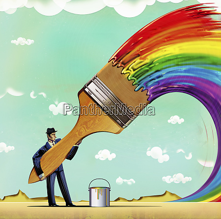 businessman with large paintbrush painting multicolored