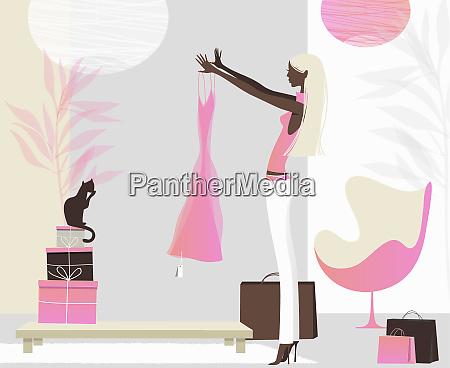 woman admiring new dress in stylish