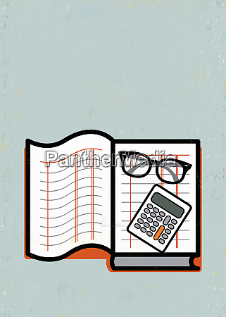 eyeglasses and calculator on ledger book