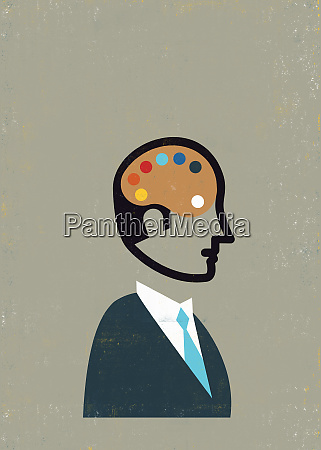 businessman with artist palette inside of