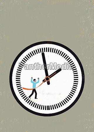 businessman crossing finish line on clock