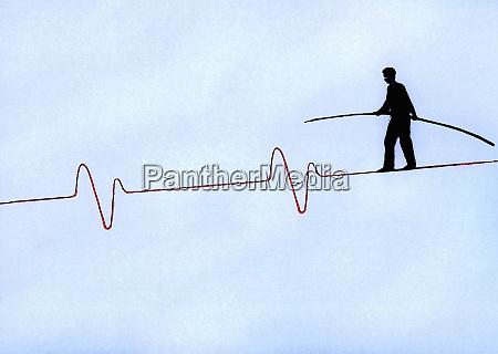 man with pole balancing on pulse