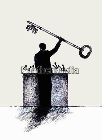 speaker at podium holding large key