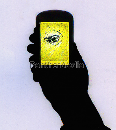 silhouette of hand holding cell phone