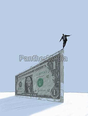businessman balancing at the edge of
