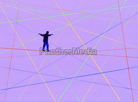 man balancing walking on complex crisscross