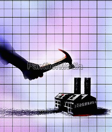 hand holding hammer hitting factory