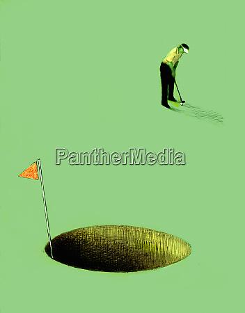 golfer putting into oversized hole