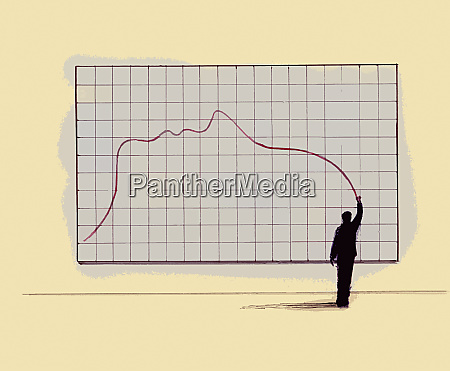 businessman drawing line graph forming profile