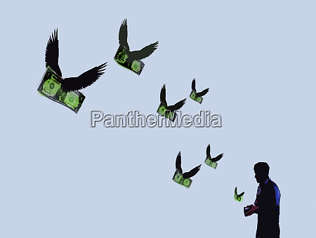 money with wings flying out of