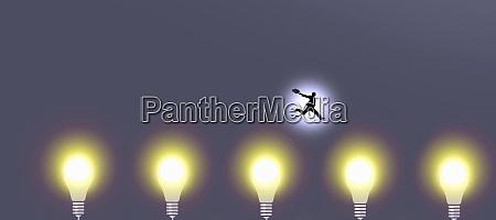 businessman jumping over glowing light bulbs