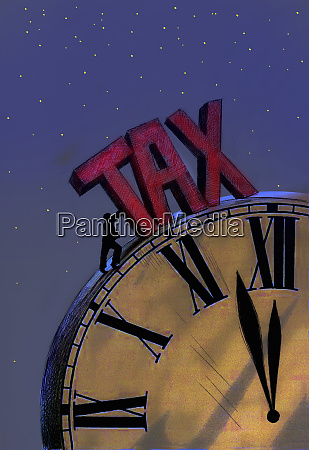 man struggling to push large tax
