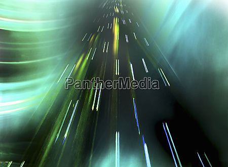 abstract pattern of light trails moving
