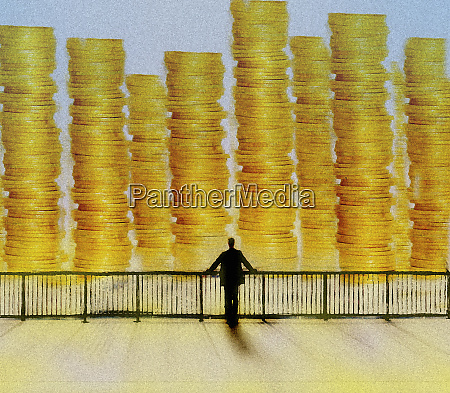 businessman looking at large piles of