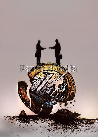 businessmen reaching to shake hands standing