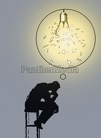businessman as the thinker with shattered