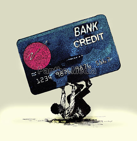 man struggling beneath large credit card