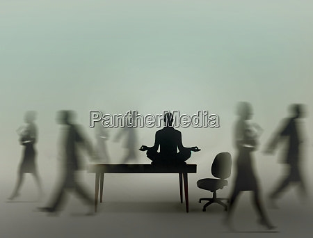 calm businessman practicing yoga meditation in