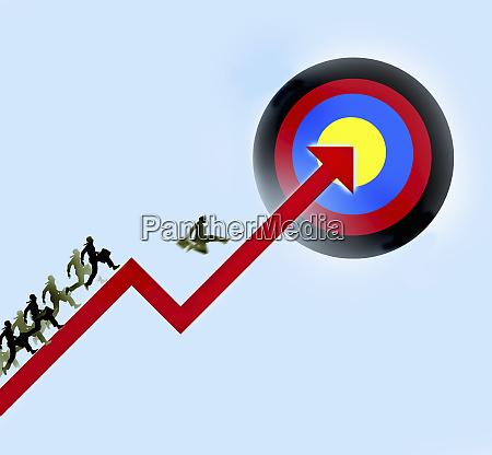 businessmen racing up arrow towards target
