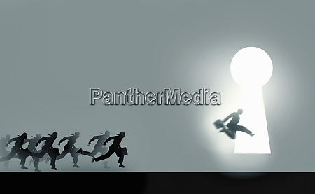 businessmen running in race to enter