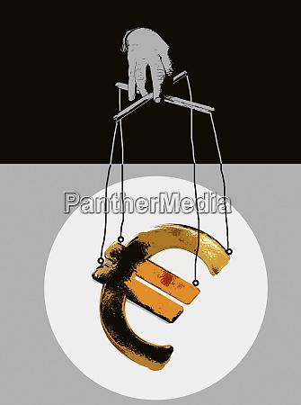 hand manipulating euro symbol puppet on