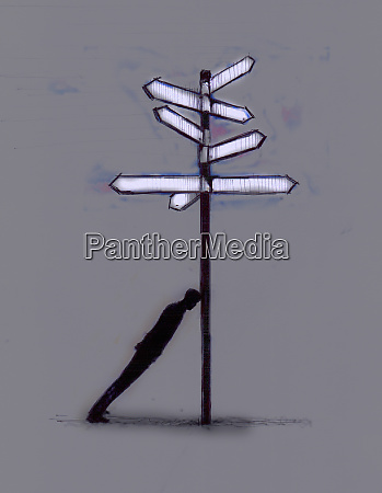 confused businessman leaning on signpost