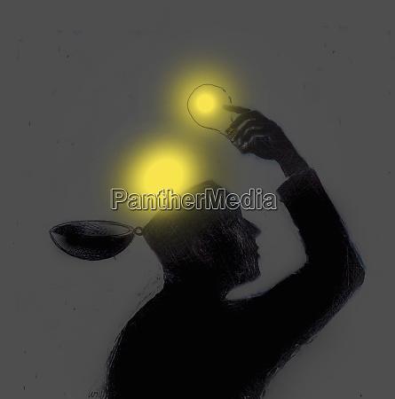 man lifting glowing light bulbs out