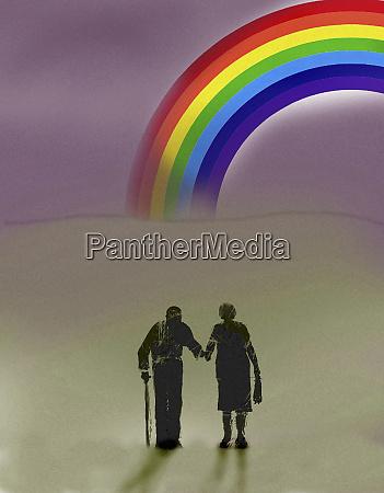 elderly couple walking towards rainbow