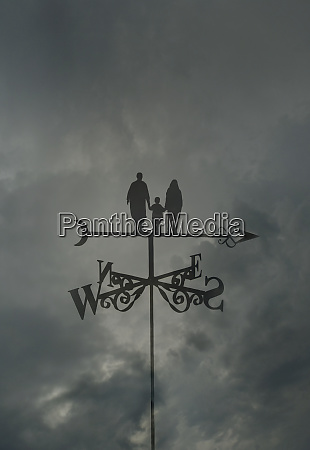 family standing on top of arrow