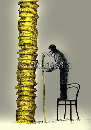 man standing on chair measuring tall