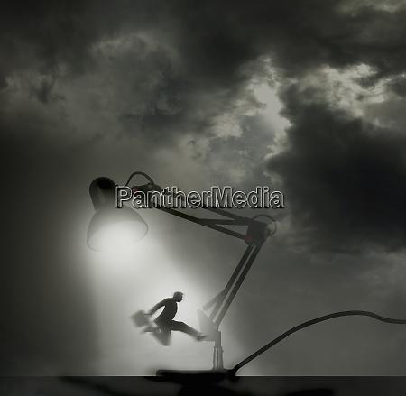 businessman running in spotlight from angle