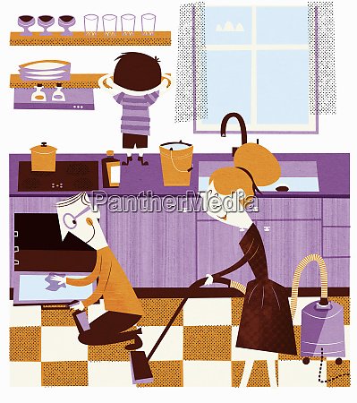 happy family working together in kitchen