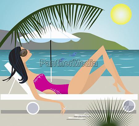 serene woman sunbathing on lounge chair