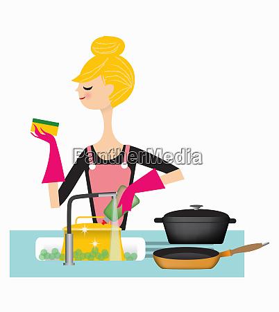 woman washing pans in kitchen sink