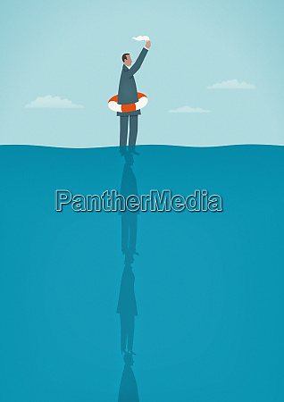 businessman in ocean waving white flag