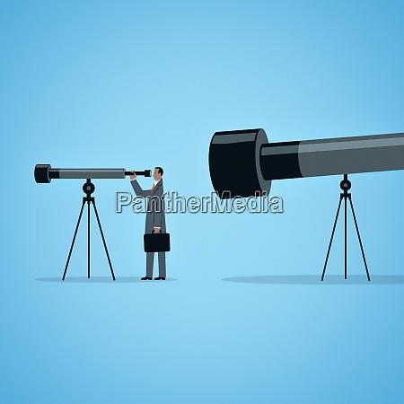 large telescope watching businessman looking through