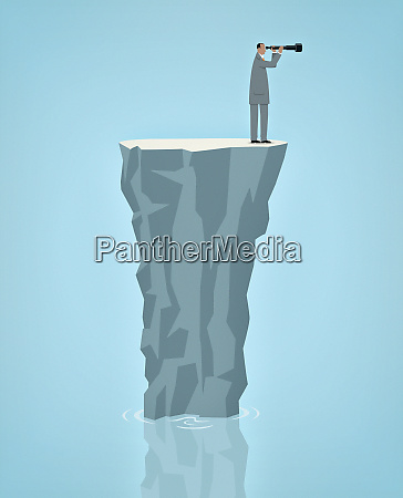 businessman stranded alone on rock in