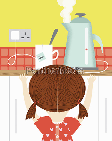 girl watching boiling kettle in kitchen