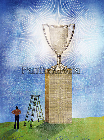 man looking at glowing trophy on