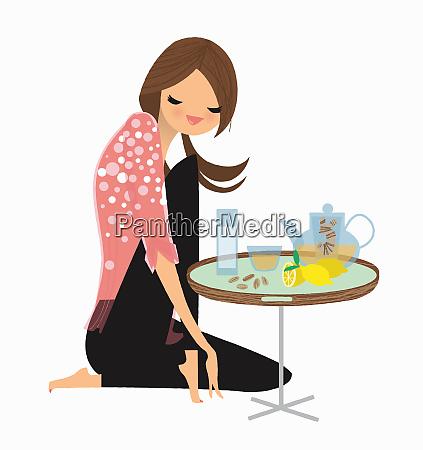 woman enjoying ginger and lemon tea