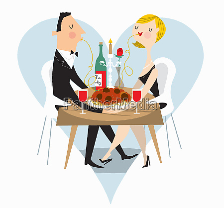 couple sharing spaghetti at romantic meal