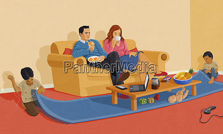 western couple watching television at home