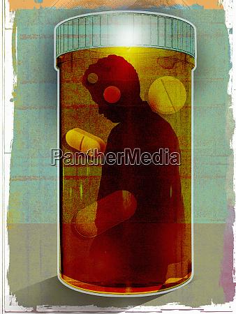 depressed man trapped inside prescription medicine