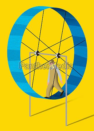man inside of exercise wheel