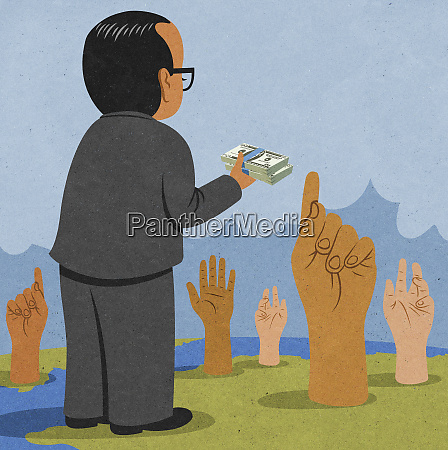 banker holding out pile of money