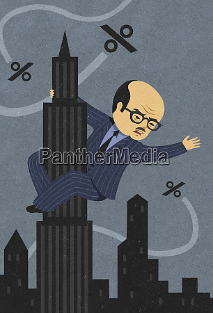 businessman as king kong clinging to