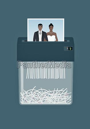 wedding photograph in paper shredder