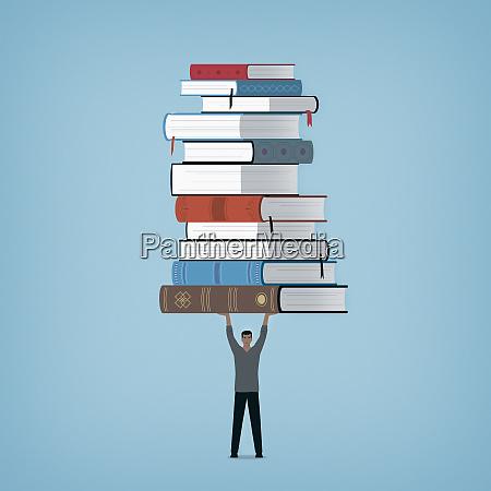 man holding large pile of books