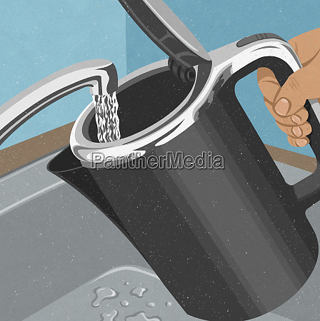 hand filling kettle with water from