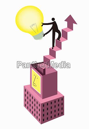 man holding light bulb ascending staircase